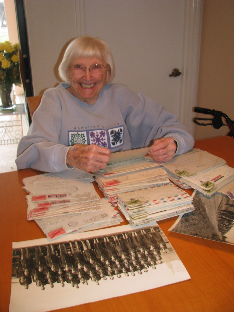 Marcella Zaborac looks at a table full of letters from John, her late husband, sent her while he was recovering from injuries sustained stateside while flying as a radio operator in a B-24 bomber during World War II and she was serving as a nurse in the Army Nurse Corps in Europe