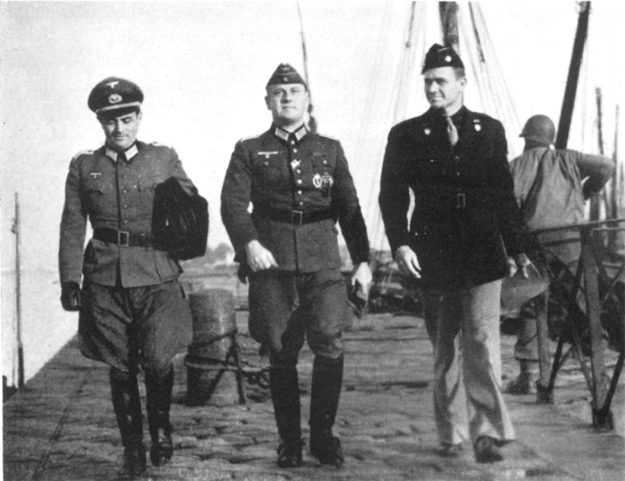 Andrew Gerow Hodges (right) is negotiating with Oberleutenant Dr. Alfrons Schmitt (left) and Oberst Otto Borst (center) for the release of the American POWs. The picture was taken on the quay at Etel, France on Nov. 16, 1944.