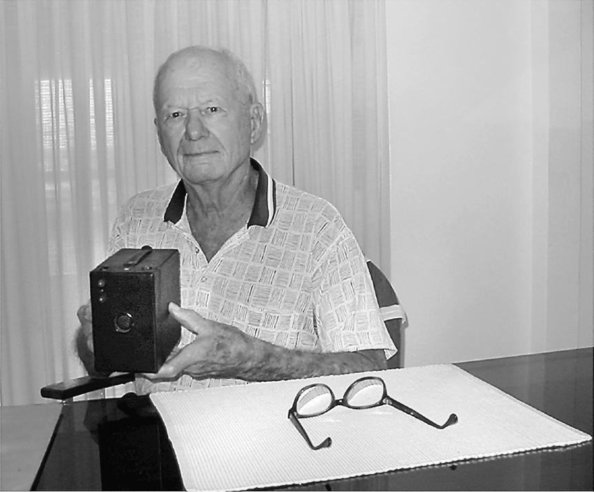 Bob Wallace, 88,  was a radio operator on a B-29 bomber that made the first firebomb raid over Tokyo. He holds his Kodak Rainbow Hawkeye camera he took to war with him. Wallace says he got the camera as a child 80 years ago.  Sun photo by Don Moore