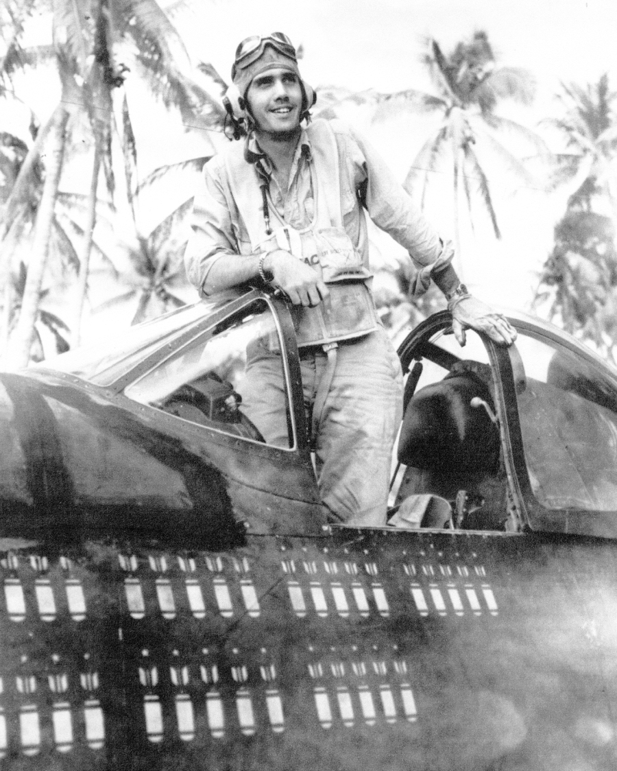 2nd Lt. William Magill is shown in his F-4U Corsair. For 15 months he flew the   plane on 89 missions, as represented by the bombs painted on its side.