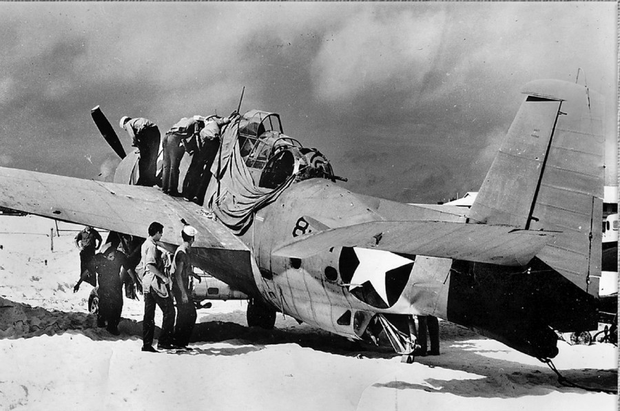 This picture of Ensign Bert  Earnest's Avenger torpedo bomber was taken  shortly after he returned to Midway Island with 64 machine gun holes and nine 20 millimeter cannon holes in it.