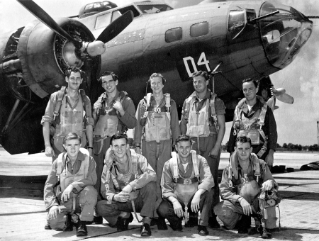 "Even though the crew of the B-17   bomber ""Straighten Up and Fly Right"" was   shot down in a raid over Germany they all   survived the ordeal. 2nd Lt. Leonard Pogue   is standing second from the right."