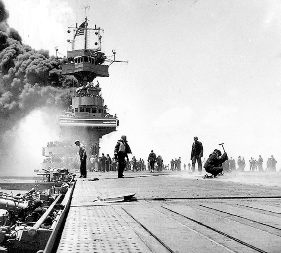 The carrier USS Yorktown is on fire after a Japanese bomb went down her smoke stack during the Battle of Midway on June 4, 1942. The picture was taken by PhoM2/C Bill Roy, a Navy photographer aboard the ship who lives in Naples, Fla.