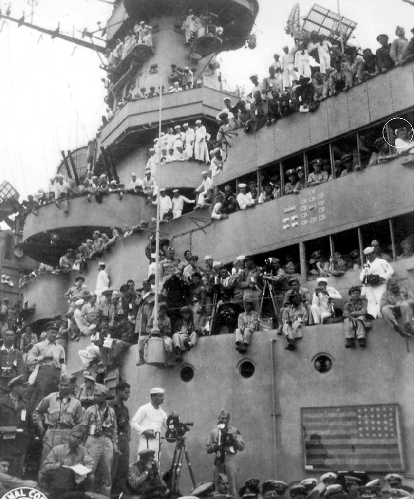 Quartermaster 3rd Class Ed Kalanta of Port Charlotte, Fla., is pictured watching the surrender ceremony from the second deck of the battleship USS Missouri. He's the sailor at the upper right in the white uniform. Photo provided by Ed Kalanta