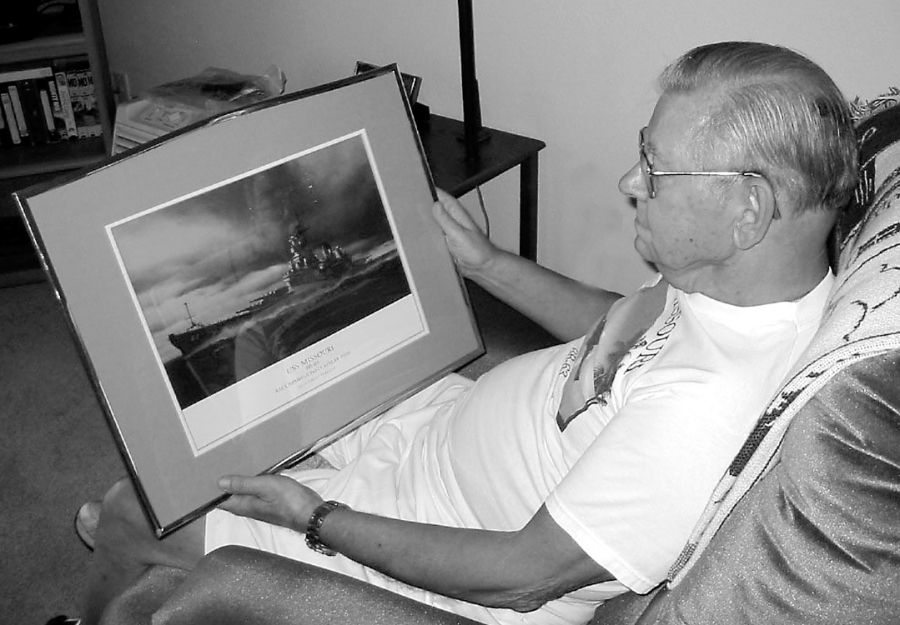 Kalanta looks at a painting of his favorite ship. As a teenage sailor World War II was a big adventure for him aboard the USS Missouri fighting at the close of the Second World War in the Pacific. Sun photo by Don Moore