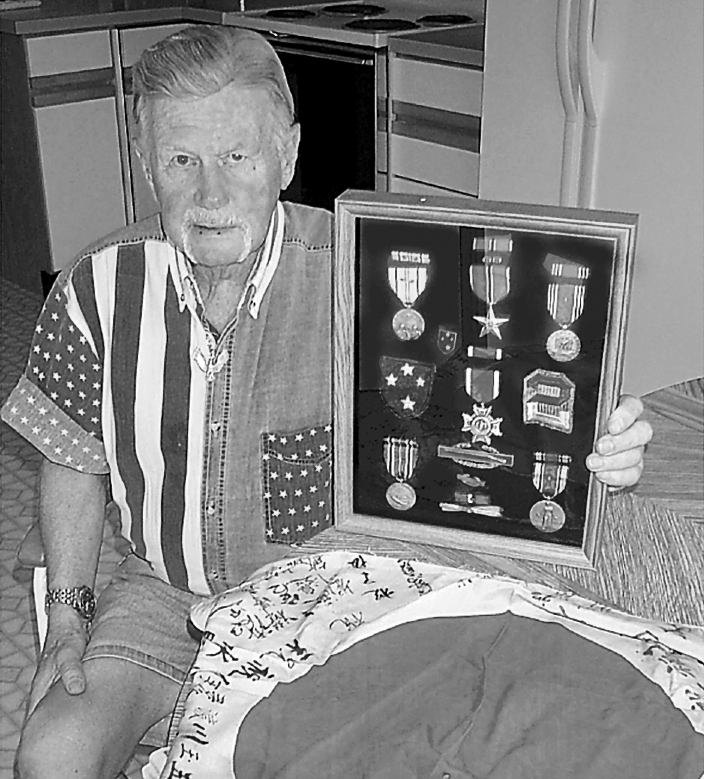The Japanese battle flag signed by the soldiers in the company is one of the items Ross brought home from the war. Besides the Combat Infantryman's Badge, he received the Bronze Star a few months ago, 57 years after it was awarded. He also has four battle stars for major conflicts he took part in during the Second World War.