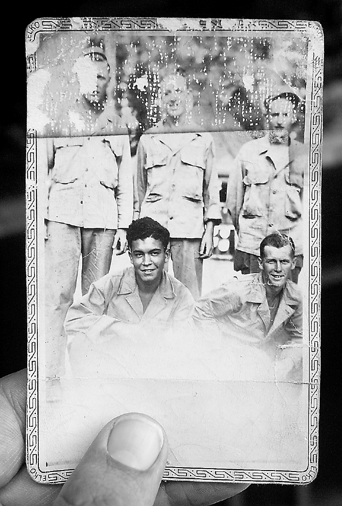 This battered old picture is one of the few souvenirs Ross still has of his service in the Pacific during World War II. It shows members of his company, he's the soldier squatting at the right.