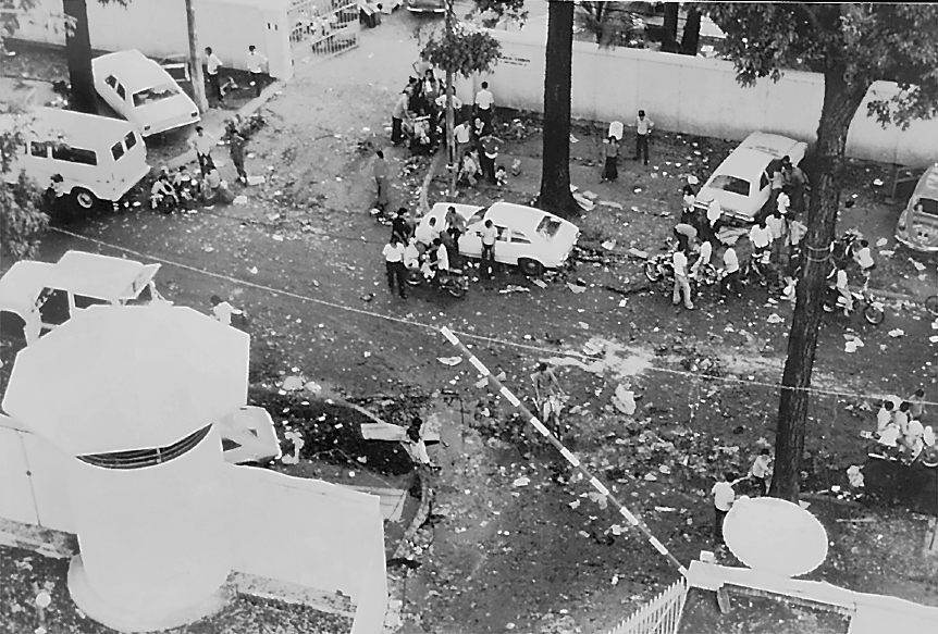 This was the scene in the street   outside the U.S. Embassy in Saigon as North   Vietnamese tanks rolled through the city.   Most South Vietnamese civilians who had any   connection with the U.S. war effort had   already been flown out to the 7th Fleet   anchored offshore or had fled the area   hoping to blend in after the enemy   takeover.
