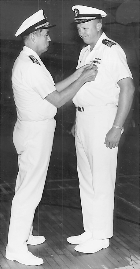 Adm. Dennis Wilkinson pins the Distinguished Service Medal on Mack for trailing a Russian sub underwater for 47 days. This is the highest peace-time commendation awarded a military officer. It's normally reserved for admirals.