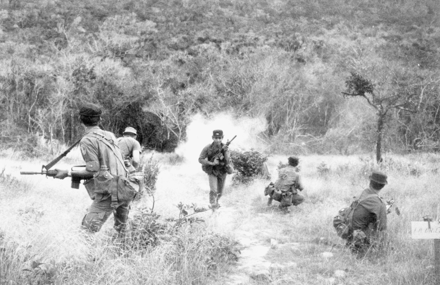 "Members of a six-man recon team practice an ""Action Drill"" in Vietnam. This was a drill so all members of the team knew what to do if they were ambushed by the enemy. The first thing they did was get out of the area with all of its members as quickly as possible. Photo provided"