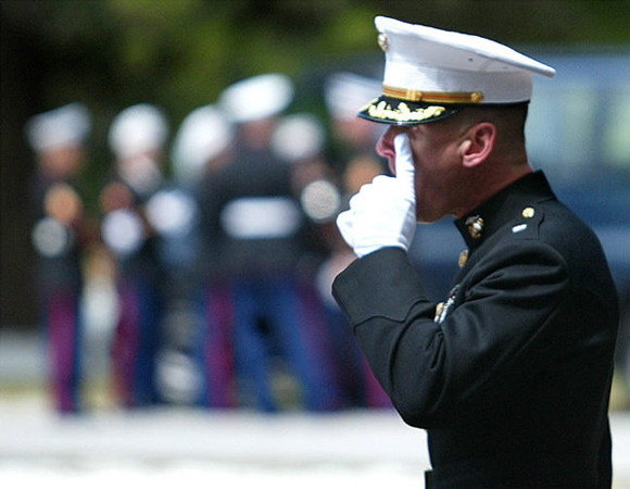 Marine Lt. Col. James Beaty, commanding the funeral detail, wipes a tear from his eye with a white-gloved finger. Sun photo by Jeffery Langlois