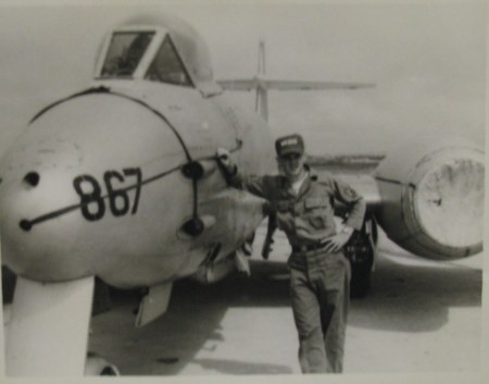 Sgt. Gil Rynex of Lakewood Village mobile home park near Punta Gorda is pictured getting a firsthand look at an Austrailan fighter plane on a U.S. Air Force Base in Kunsan, South Korea during the Korean War. Photo provided
