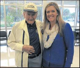 Hank Chiminiello — wearing a VFW hat, a Lions Club jacket and a Glenallen Elementary shirt — is pictured with Glenallen principal Amy Archer. Chiminiello was a longtime volunteer at the North Port school.