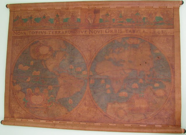 A reproduction of an ancient map of the world produced on fabric Drew found in Noriega's office while his unit emptied the Panamanian leaders files of incriminating papers for his pending trial that put him behind bars in the U.S. for years. The map has an honored spot on the wall of Drew's Englewood home. Sun photo by Don Moore