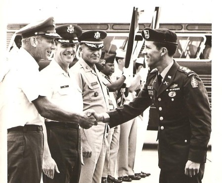 Stephen Leopold in a Green Beret uniform (right) given him at Clark Air Force base in the Philippines shakes hands in 1973 with officers at the base. He had been released days earlier from a North Vietnamese POW camp  after five years in prison. Photo provided
