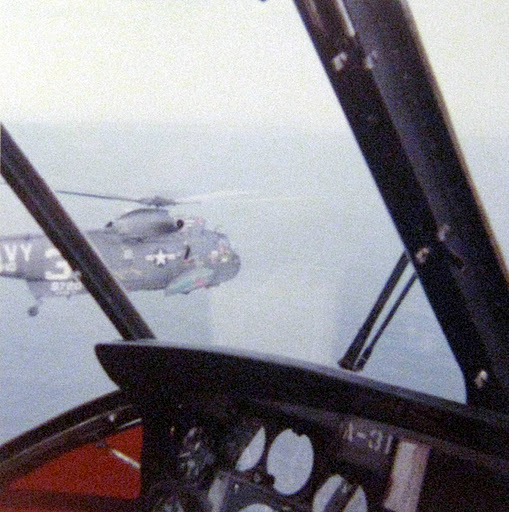 "On a mission with a flight of ""Sea King"" helicopters. This picture was shot with McClure at the controls. These helicopters were used widely by the U.S. Navy for decades.  Photo provided"
