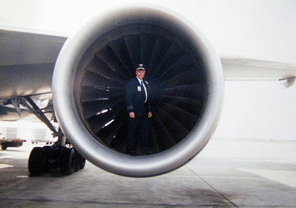 McClure stands in the engine  of a Boeing 777 airliner.  He flew for decades for United Airlines after he got out of the service. Photo provided
