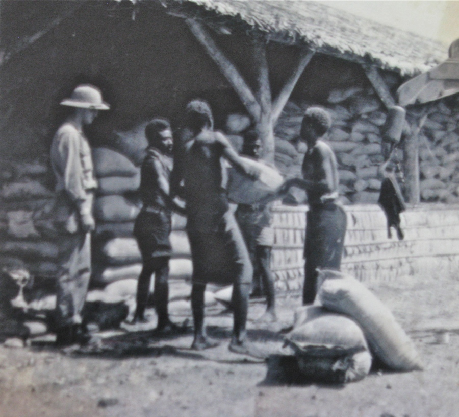 Former Cpl. Walter Mitchell of Englewood, Fla. supervises a group of natives moving sacks of grain out of a warehouse the Americans built on Guadalcanal during WW II. Photo provided by Walter Mitchell