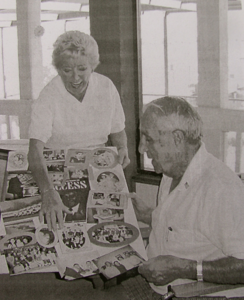 "Hazel Nicholas shows her husband, Art, a poster she is making to commemorate his life. It's for his 80th birthday which is Feb. 15. He was a ""frogman"" and boatswain's mate in the Navy in World War II. Sun photo by Don Moore"
