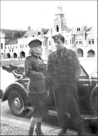 Second Lt. Art Faloris of Rotonda talks to a beautiful Russian army doctor outside a bar in Plzen, Czechoslovakia, near the end of the war in Europe during World War II. Photo provided