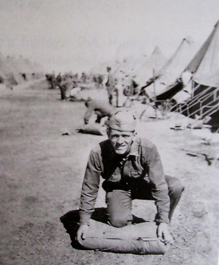 Farino's buddy, Pvt. Henry Gonzalez of Boston, packs up while on maneuvers in the Carolinas before World War II. They were both in Company C, 182nd Infantry, Massachusetts National Guard. Even in those days Farino wanted to be a photographer. Photo by Sgt. Patrick Farino
