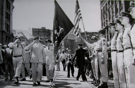 Gen. Douglas Mac Arthur (center left) salutes as he passes a color guard during a parade in his honor in Boston. The photo was taken shortly after he was fired by President Harry Truman as commander of forces in the Pacific during the Korean War era. Photo by Sgt. Patrick Farino