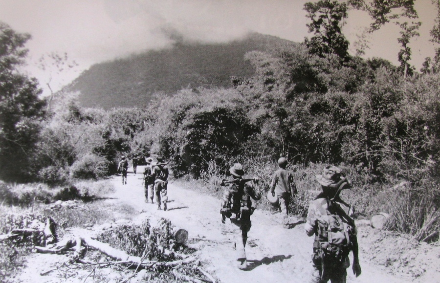 Members of a U.S. Special Forces strike force begin an attack on Black Virgin Mountain, a Viet Cong stronghold in South Vietnam, during the summer of 1964. This is where Sgt. Jewett as shot and nearly killed. Photo provided by Dick Hornyak