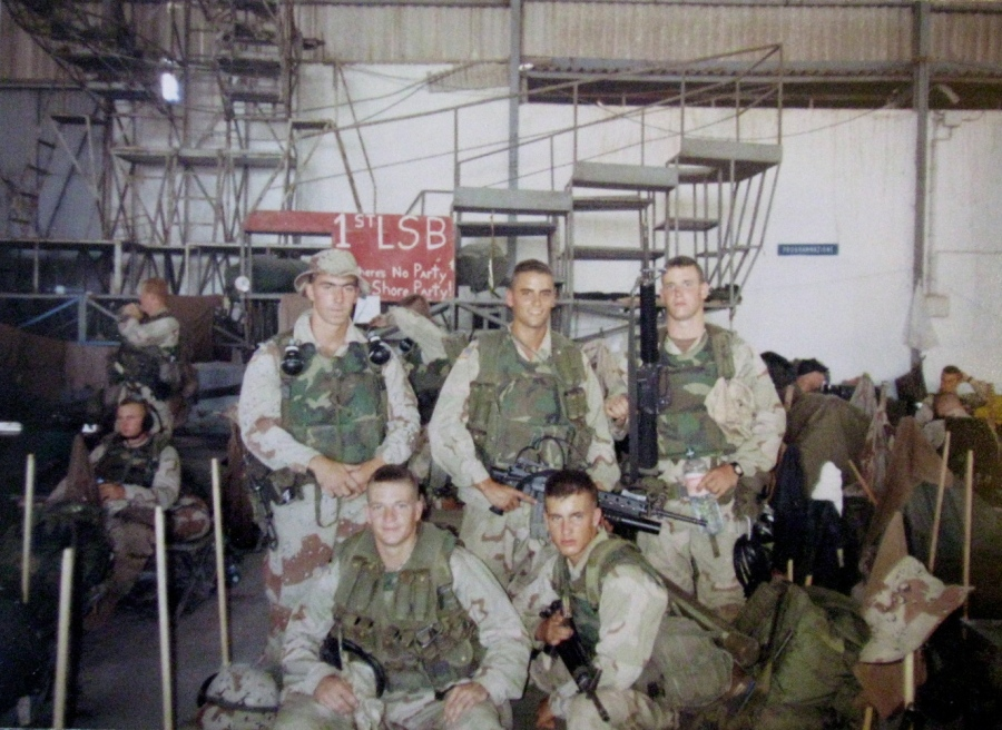 "Good, squatting front left, and Pfc. Todd Blackburn, (beside him) who was seriously wounded during one mission, is pictured with other members of their platoon, known as ""Chalks."" Photo provided"