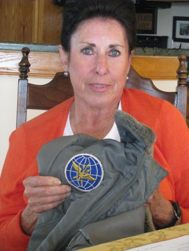 Carr holds an Air Force jacket she wore in the service. It has the shoulder patch of the Military Air Transport Command. Sun photo by Don Moore