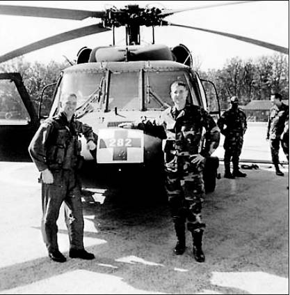 Maj. Arturo Rodriguez-Martin, right, in front of a rescue helicopter with its pilot when Rodriguez-Martin served with a U.S. Army medical unit in Bosnia in 2002. Photo provided