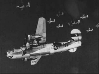 Lt. Adam Kubinciak was piloting the B-24 in the foreground during a combat mission over Germany. His crew flew 34 missions over Nazi-occupied Europe during the war. Photo provided