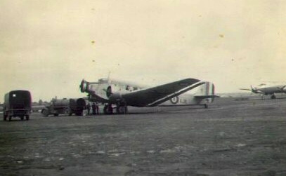 "This German JU-52 Junkers tri-motor transport plane sits on the runway at Frankfurt, Germany waiting to be loaded during the ""Berlin Air Lift"" of 1948-49. The interesting point is the plane has French markings and is being flown into Berlin to supply starving Berliners by a French crew. Photo provided"