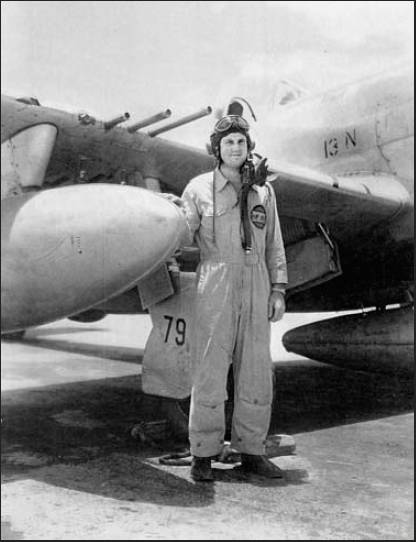 "First Lt. Hal Johnson stands in front of his P-47 ""Thunderbolt"" fighter after World War II when he was flying with the 81st Fighter Group, 91st Squadron, stationed at Wheeler Field in Hawaii. Photo provided"