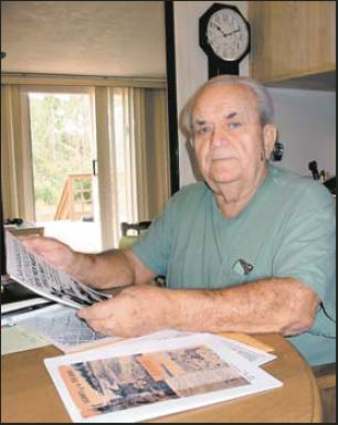 Former Seaman James Friel of south Punta Gorda looks at an article about the naval battle off Guadalcanal in November 1942 that helped change the outcome of World War II in America's favor. Sun photo by Don Moore