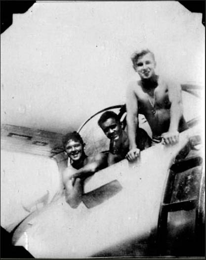 "Dick Brown is the sailor at the left smiling from a PBY ""flying boat"" with his two buddies, Manuel Rodriguez from Texas and Art Loveland of Pennsylvania on Saipan Island during World War II.  Photo provided"