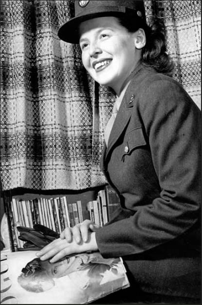 "This is an Army publicity picture taken of Winifred Leiser reading ""Vogue"" magazine during the war. This is one of many the Army took of Leiser to promote the WACS in World War II."