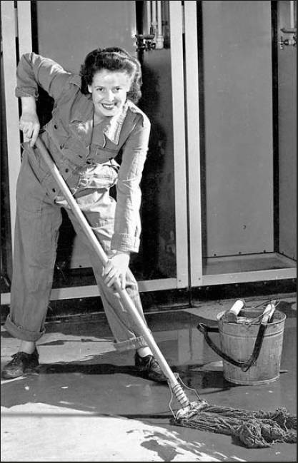 This is Winifred Leiser in an Army publicity shot with a smile on her face as she presumably cleaned up the place for Uncle Sam.