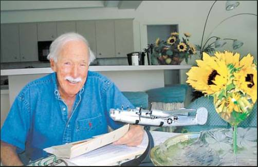 "Former 1st Lt. Ed Sealy is pictured at his home in Southwest Florida with a model of a B-24 ""Liberator"" bomber like one he flew on 35 missions over Nazi-occupied Europe during World War II.  Sun photo by Don Moore"