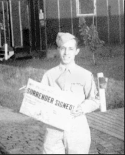 "Vincent Durand holds a copy of the local newspaper that says it all: ""SURRENDER SIGNED!"" This picture was taken at an air base near Madison, Wis., after he returned from his tour with the 8th Air Force in England during World War II. Photo provided"