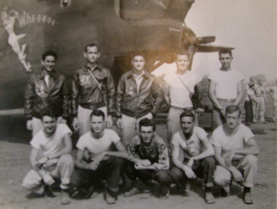 "This is the 10-man crew of ""Passionate Witch,"" a B-24, part of the 13th Air Force, 50th Bomb Group, 23rd Bomb Squadron. Driver is the sergeant at the far left squatting. Photo provided"