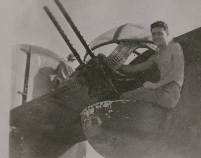 "Driver is pictured in the rear turret of his B-24 ""Liberator"" at his twin .50 caliber machine-guns. Photo provided"