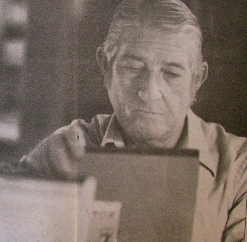 Glenn Jenkins sits at his desk in his home, checking his records on work he recently completed. The navy vet was 60 years old  at the time (Oct. 1987) this picture was taken, and was suffering from a variety of medical problems as a result of his stint in the gas chambers while in the Navy. Sun photo by Don Moore