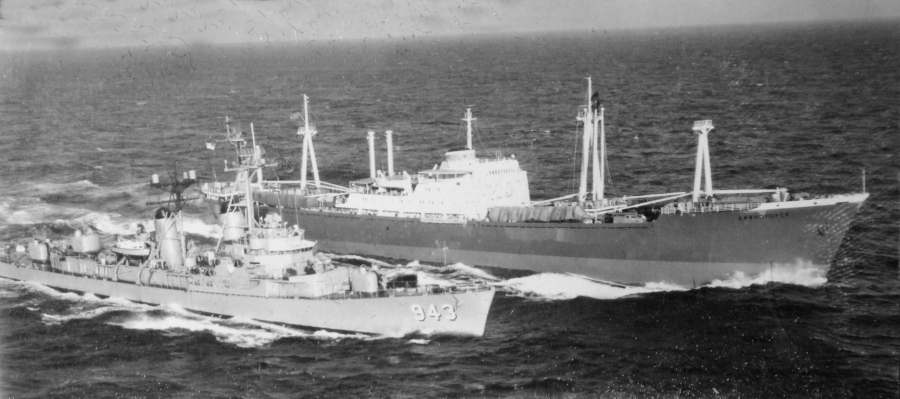 A U.S. destroyer moves in close to a Soviet freighter whose skipper refused to take the canvas covers off the Russian missile it was hauling out of Cuba in October of'62 during the crisis. Photo provided