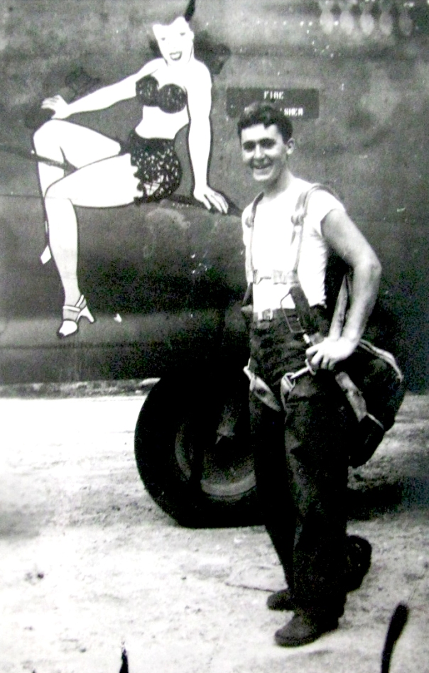 "Carl Driver of Alligator Mobile Home Park south of Punta Gorda, Fla. was a tailgunner on a B-24 ""Liberator"" in World War II. He stands beside the nose art on his bomber ""Passionate Witch."" he flew in the 13th Air Force in the Pacific. Photo provided"