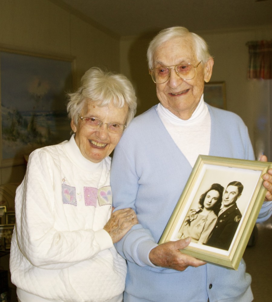 Maria and Clayton Raynes of La Casa mobile home park are the guests of honor today at a 70th wedding anniversary celebration attended by family and friends from around the country. The 93-year-old couple is holding their wedding picture taken March 17, 1943, during World War II, when they were 22. Sun photo by Mary Auenson