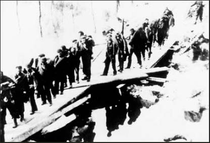 This picture showing PoWs from Jay Fish's PoW camp walking across the Torgan River in Germany in the snow trying to escape to safety. Photo provided