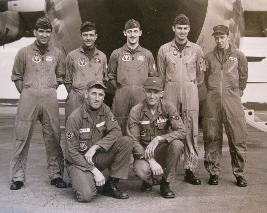 "This was the C-130 ""Hercules"" crew that flew part of the 500 Belgium paratroopers to the Belgium, Congo to quell a native uprising. Norman is the airman at the far left squatting. Photo provided"