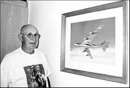 Former Maj. Nick Firda looks at a picture of a B-52G model bomber like the one he flew around the world loaded with atomic bombs as a deterrent to aggressive enemy forces during the Cold War of the 1960s.  Sun photo by Don Moore