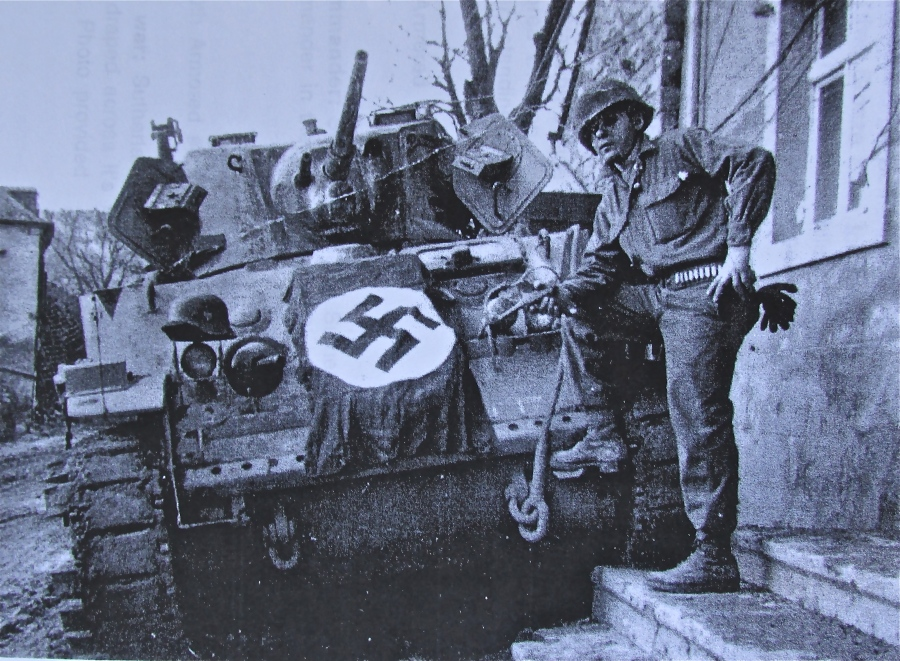 Sgt. George Sutherland is pictured with one of his 5 light tanks with a Nazi flag draped over the front. His platoon spearheaded Gen. George Patton's 3rd Army advance across Europe during World War II. Sutherland's tank squad was part of the 10th Armored Division. Photo provided
