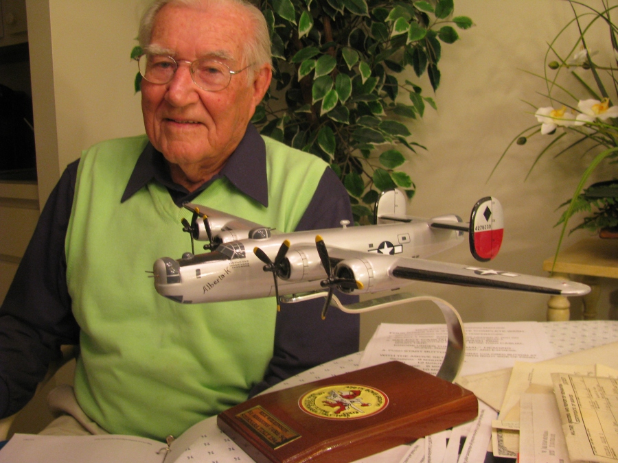 Rex Wilkinson today at 92 telling his war story. A model of his B-24, 4-engine heavy bomber sits in front of him. Sun photo by Don Moore